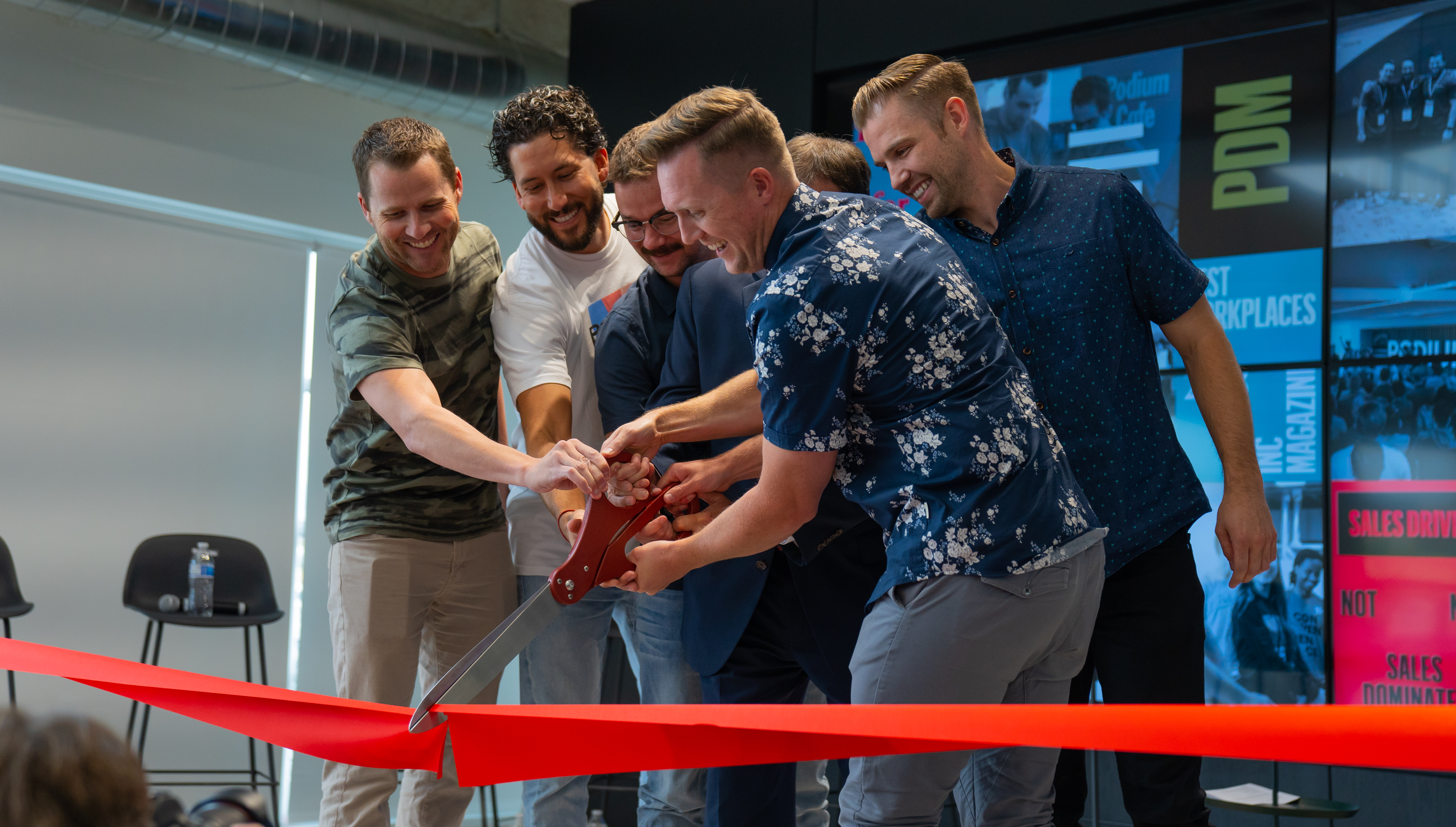 PODIUM-RIBBON-CUTTING-1